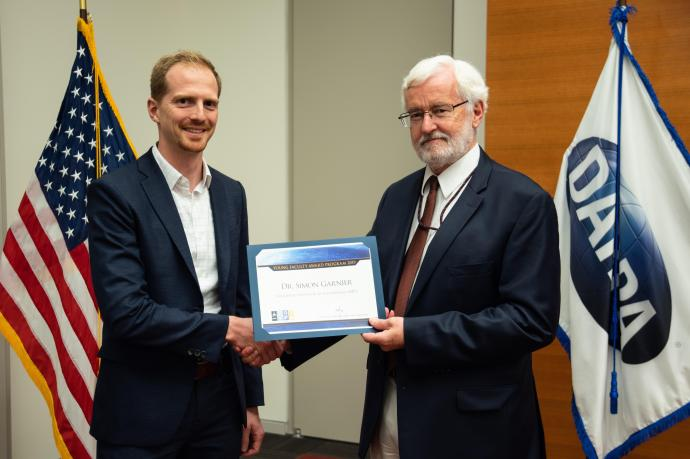 Simon Garnier receives YFA honors from Michael Fiddy, program manager for DARPA's Defense Sciences Office.