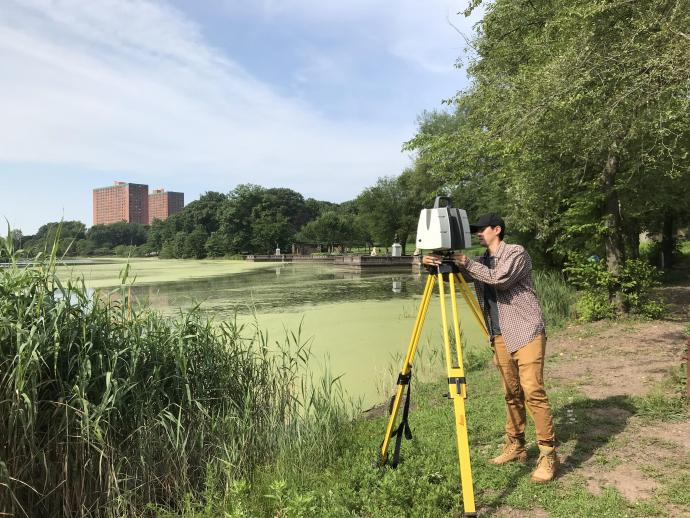 Performing a 360-degree scan of the lake using the laser scan system.
