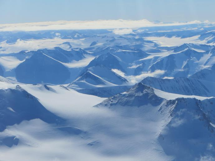 Flying over mountainous terrain.