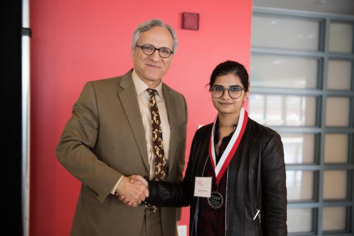 NJIT Provost and Senior Executive Vice President Fadi P. Deek awards graduate student Sherry Chhabra.