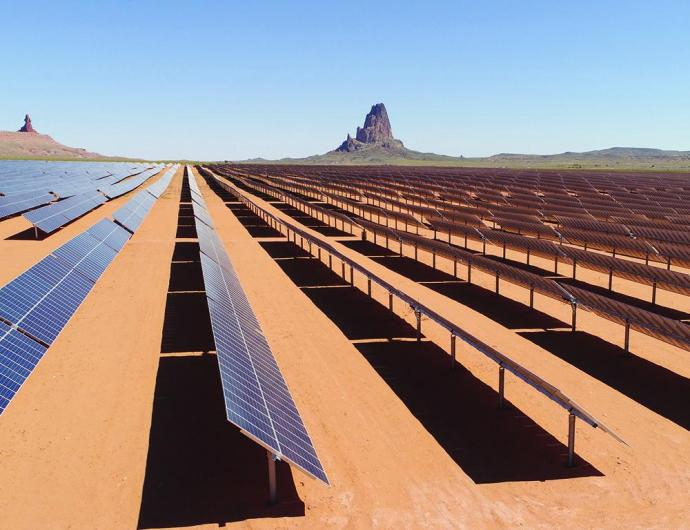 Automated solar panel arrays convert sunlight to electricity at the Kayenta Solar Project facility in Kayenta, Arizona.