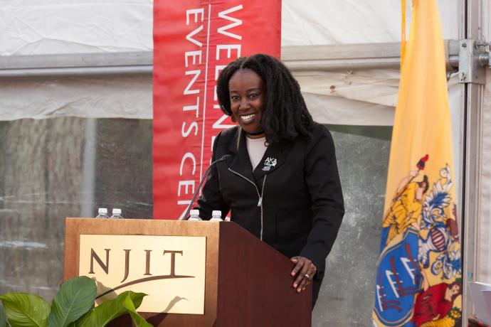 Lucie Thibeaud Tchouassi '94, a former member of the NJIT women's basketball team, gave remarks at the WEC Ribbon-Cutting Ceremony.