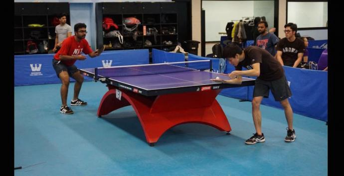 Vivek Kanakamedala (left), an engineering management graduate student, established a Highlanders table tennis team.