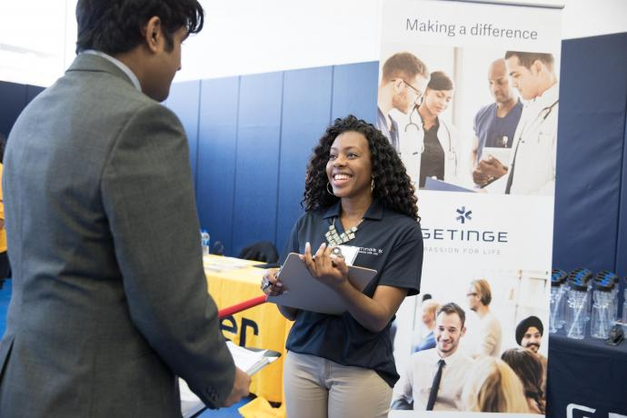 Whitney Randolph '17 recruited for her employer, Getinge, at the Spring 2018 Career Fair.
