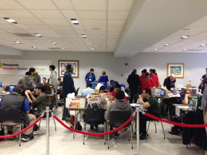CDC teams gather at their workstations before the event begins.