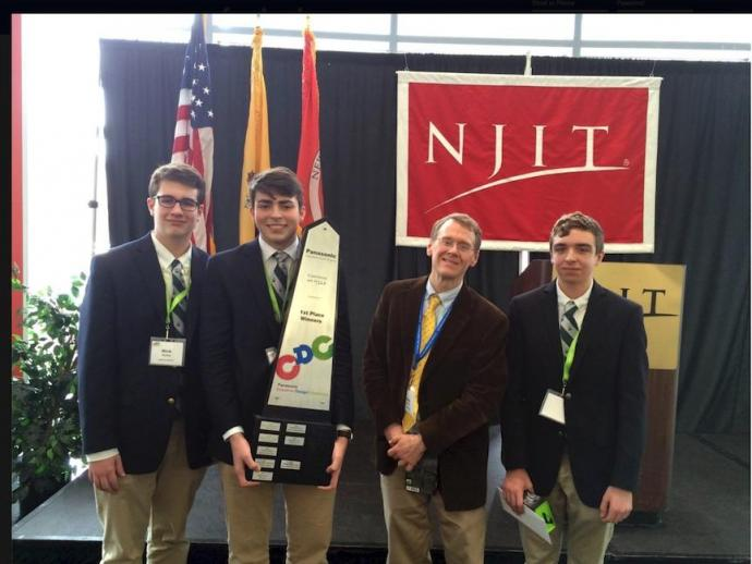 (From left) The Delbarton School's Nick Eichler, Mark Castellano, Adviser Greg Devine and Noah Jerris emerge victorious.