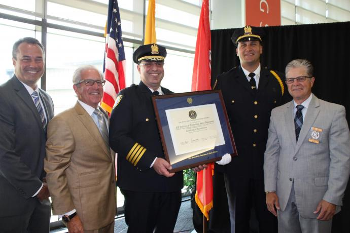 Accepting the NJSACOP accreditation certificate are (from left) Andrew Christ, VP, real estate development and capital operations; Joel S. Bloom, president; Joseph Marswillo, NJIT police chief; Lt. Mike Villani; Harry J. Delgado, NJSACOP.