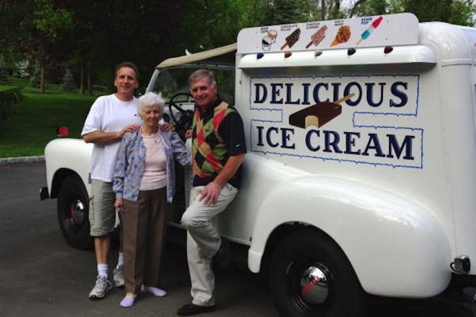 (From left) Joe Marazzo with his mother and brother, John, in front of the business' restored 1950 Chevy truck.