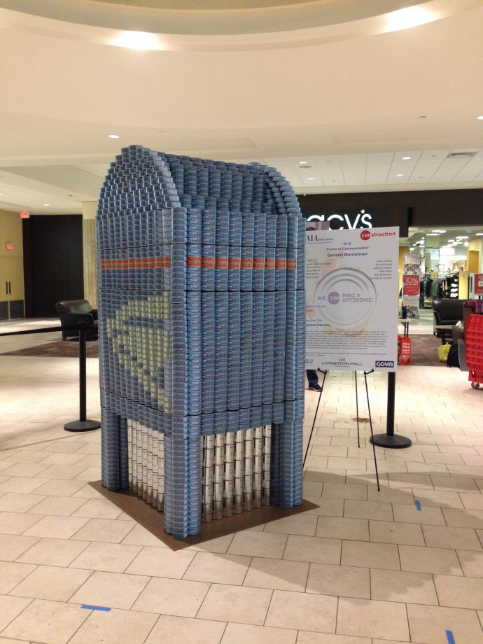 The structure stands 72 tuna cans high (7 foot 6 inches) and 3 feet wide by 3.5 feet deep.