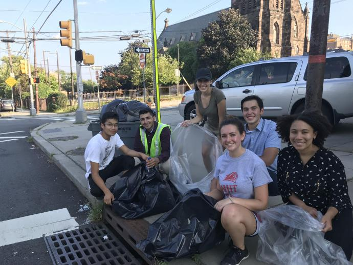 NJIT's catch basin crew collecting trash before it pollutes or clogs the sewer system.