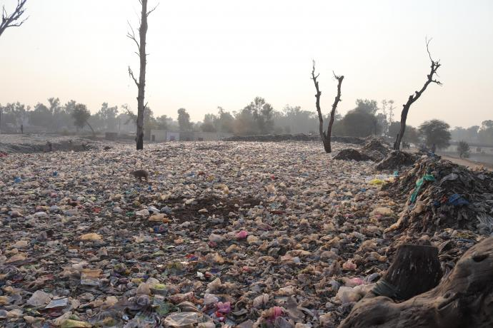 A huge garbage dumping point near a canal. Photo credit Muhammad Numan on Unsplash