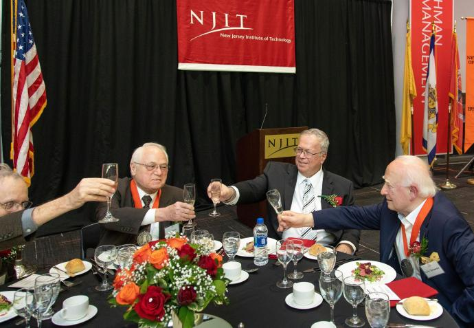 NCE 100 Honorees Pierre Ramond, Heinz Bloch and Yuriy Tarnawsky share a toast with NCE Dean Moshe Kam (second from right).