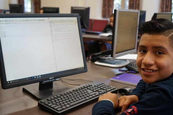 A young coder takes a break from learning Python, a robust computer programming language.
