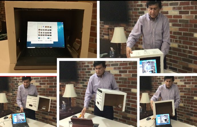 Judge Mohammed's DIY privacy guard for virtual court proceedings, fashioned from a moving box.