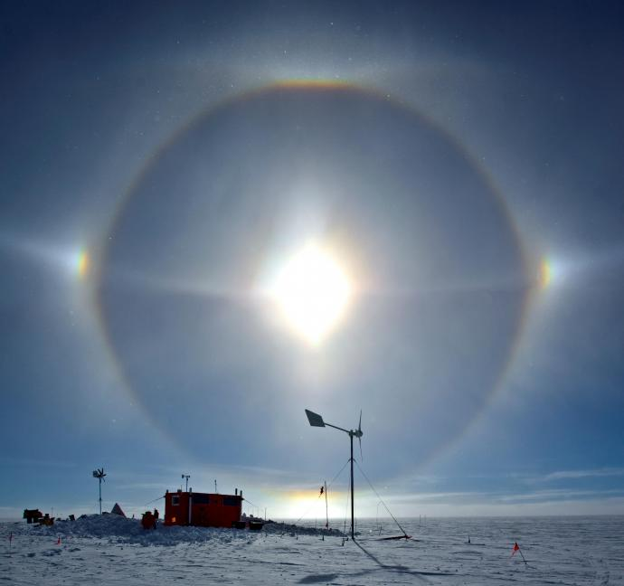 A sundog, or perihelion, luminous arcs formed by thin ice crystals at cold temperatures that lead and follow the Sun like two playful puppies.