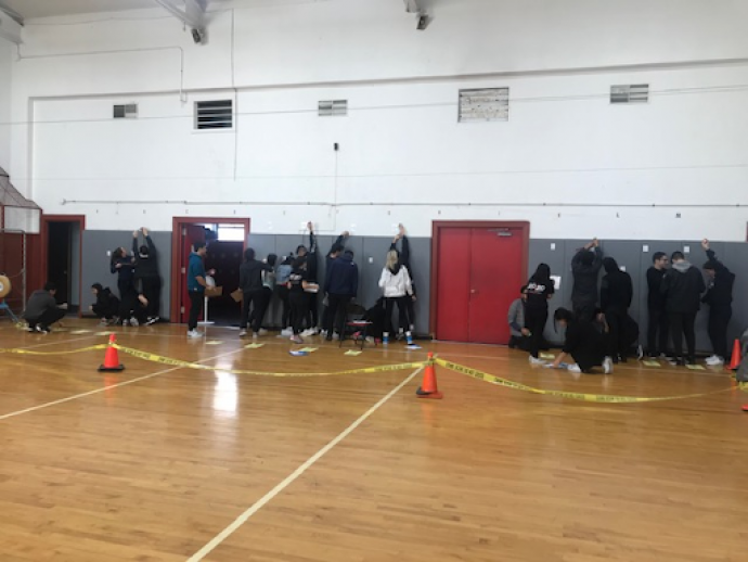 In Newark's East Side High School gymnasium, Carman's class learn to take bullet trajectory measurements the way forensic scientists do to determine the height of a shooter.